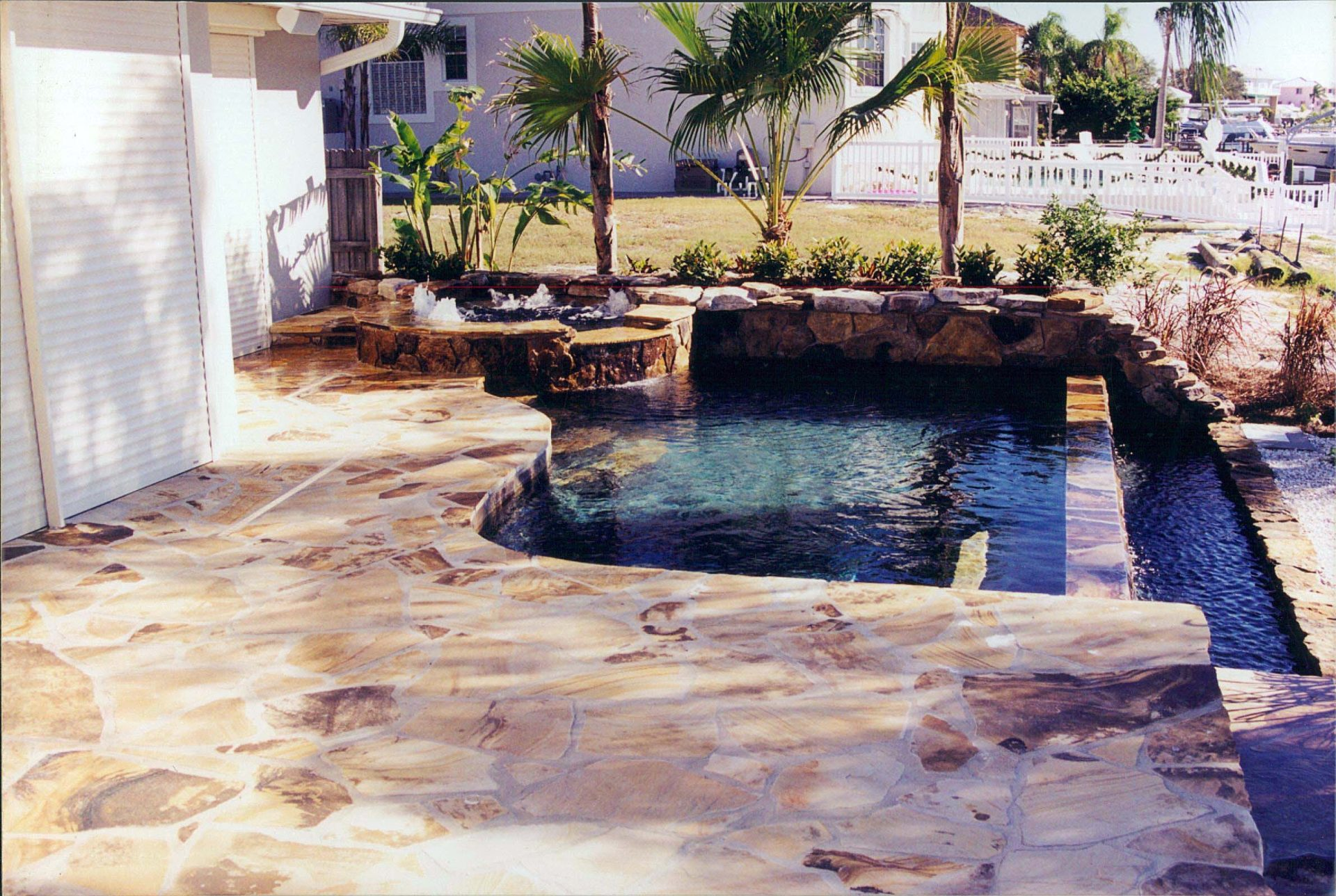 Custom Flagstone Patio and Pool Deck by Waterscapes Inc.