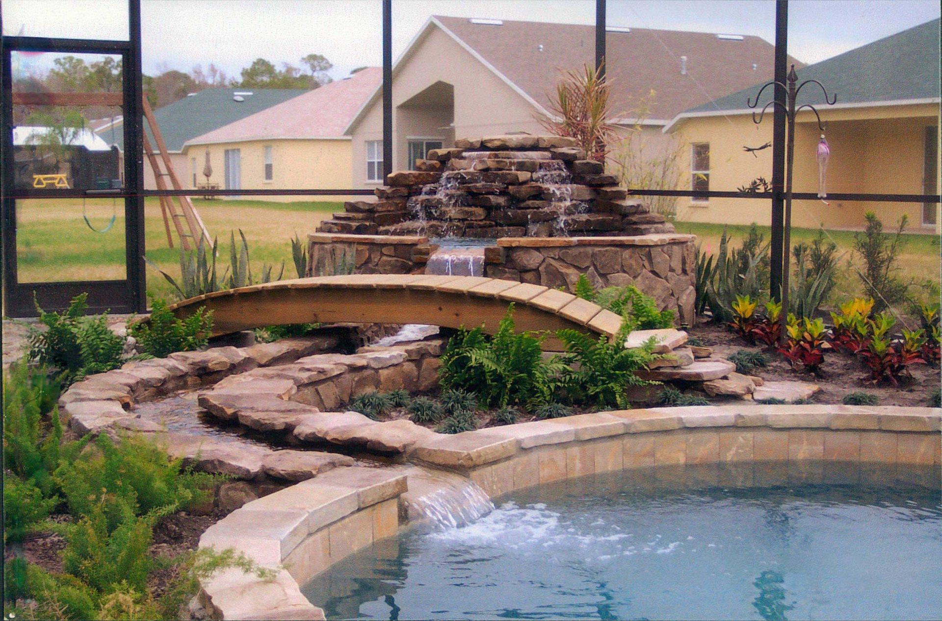 Custom Pool Spa Spillover and Stream by Waterscapes Inc.