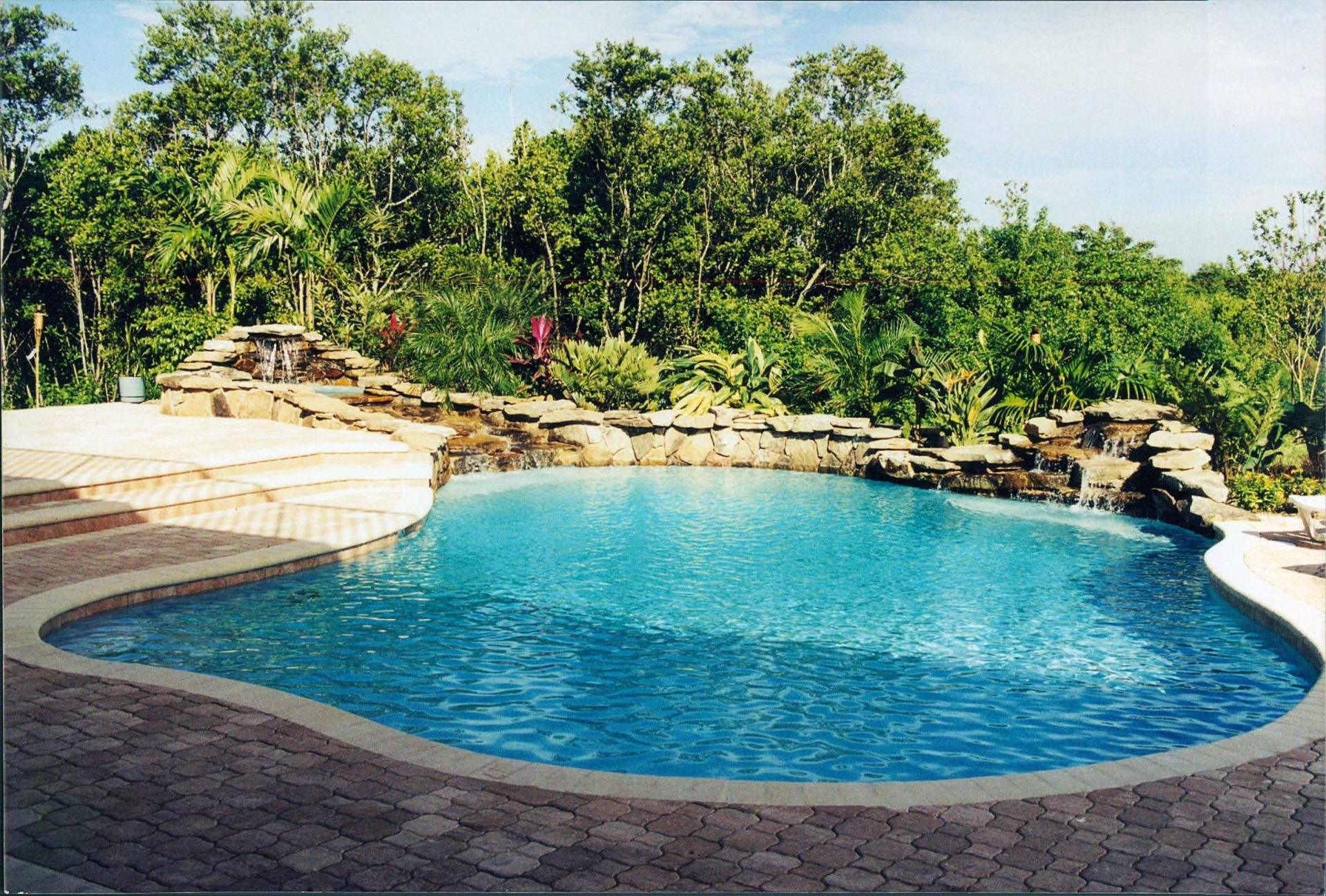 Custom Pool Waterfall by Waterscapes Inc.